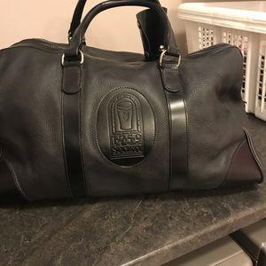 Handbags - Roots black leather duffel bag
